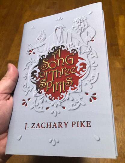 A hardback copy of A Song of Three Spirits